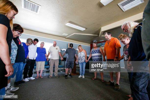 Christian Fellowship of Trona congregants pray after holding a quick meeting on how to help other community members July 7 2019 after big earthquakes...
