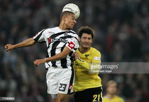 Christian Fiel of Aachen fights for the ball with Marcel Ndjeng of Moenchengladbach during the Second Bundesliga match between Borussia...