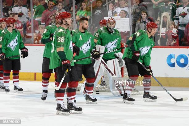 Christian Fischer of the Arizona Coyotes and his teammates wear special green warm up jerseys in recognition of St Patrick's Day prior to a game...