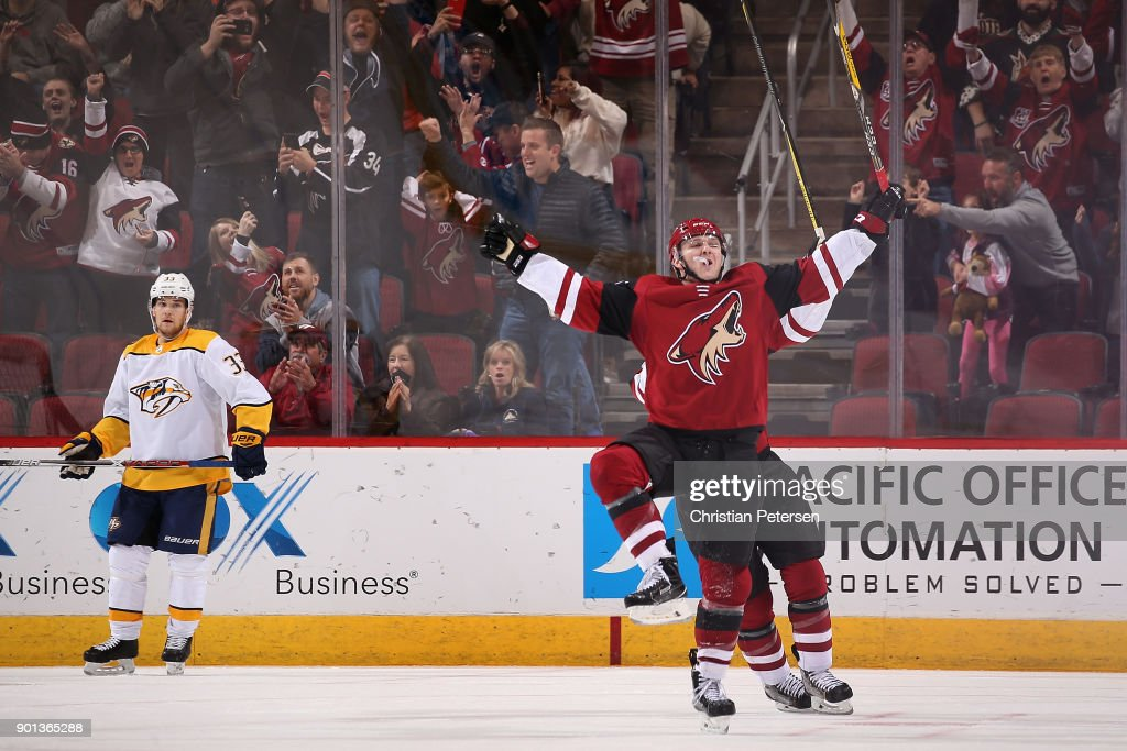Christian Fischer #36 of the Arizona Coyotes celebrates after scoring the game winning overtime goal against the Nashville Predators in the NHL game at Gila River Arena on January 4, 2018 in Glendale, Arizona. The Coyotes defeated the Predators 3-2 in overtime.