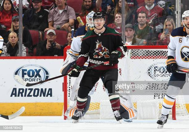 Christian Fischer of the Arizona Coyotes looks for the puck while screening Linus Ullmark of the Buffalo Sabres at Gila River Arena on October 13...