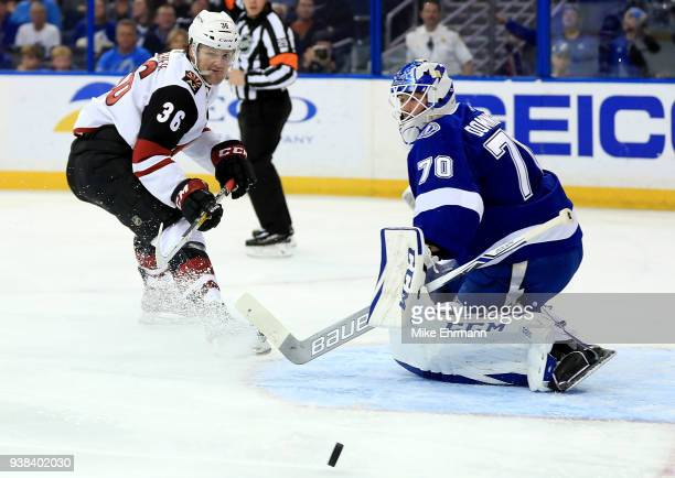 Christian Fischer of the Arizona Coyotes takes a shot on Louis Domingue of the Tampa Bay Lightning during a game at Amalie Arena on March 26 2018 in...