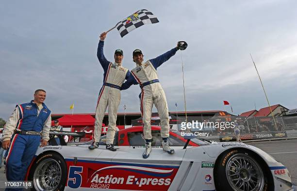 Christian Fittipaldi and Joao Barbosa of Brazil celebrate after winning the Diamond Cellar Classic at MidOhio Sports Car Course on June 15 2013 in...