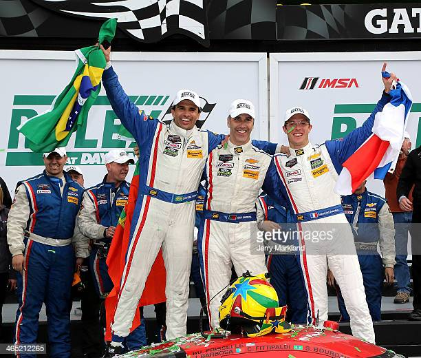 Christian Fittipaldi, Joao Barbosa and Sebastien Bourdais drivers of the Action Express Racing Corvette DP celebrate on the podium after winning the...