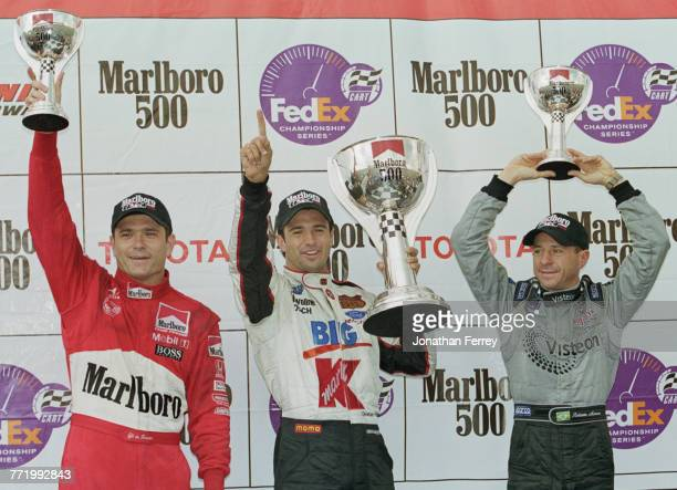 Christian Fittipaldi of Brazil and driver of the Newman/Haas Racing Lola B2K/00 FordCosworth XF celebrates with compatriots second placed Roberto...