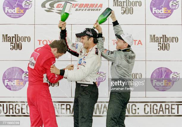 Christian Fittipaldi of Brazil and driver of the Newman/Haas Racing Lola B2K/00 Ford-Cosworth XF celebrates with compatriots second placed Roberto...