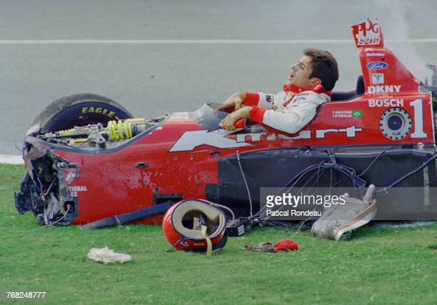 Christian Fittipaldi of Brazil attempts to climb out of the NewmanHaas RacingSwift 007i Ford XD following his crash during the Championship Auto...