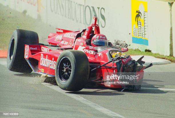 Christian Fittipaldi of Brazil crashes the NewmanHaas RacingSwift 007i Ford XD during the Championship Auto Racing Teams 1997 PPG Indy Car World...