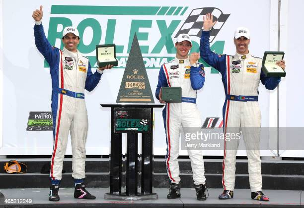 Christian Fittipaldi, Sebastien Bourdais and Joao Barbosa drivers of the Action Express Racing Corvette DP celebrate on the podium after winning the...