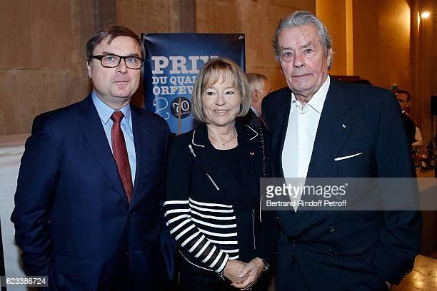 Christian Flaesch Martine Monteil and Alain Delon attend the 70 th Anniversary of Prix du Quai des Orfevres at 36 quai des Orfevres on November 15...