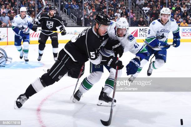 Christian Folin of the Los Angeles Kings battles for the puck against Sven Baertschi of the Vancouver Canucks at STAPLES Center on September 16 2017...