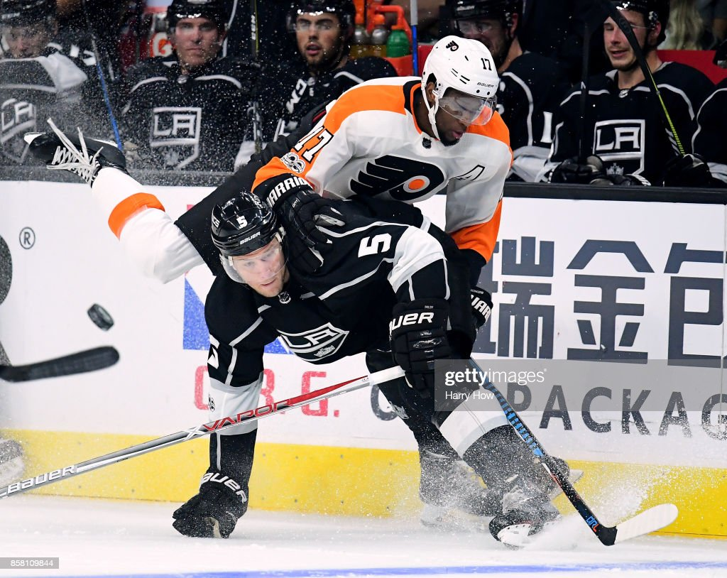 Christian Folin #5 of the Los Angeles Kings checks Wayne Simmonds #17 of the Philadelphia Flyers during a 2-0 win over the Philadelphia Flyers on opening night of the Los Angeles Kings 2017-2018 season at Staples Center on October 5, 2017 in Los Angeles, California.