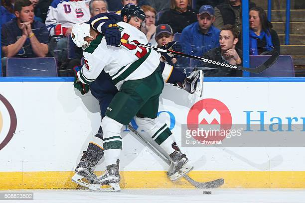 Christian Folin of the Minnesota Wild checks Jori Lehtera of the St. Louis Blues at the Scottrade Center on February 6, 2016 in St. Louis, Missouri.