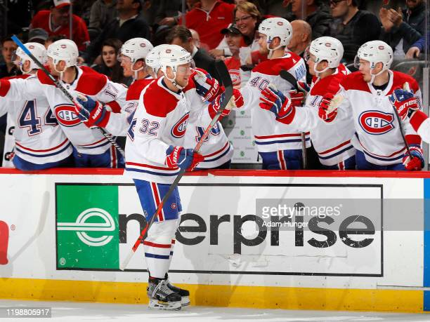 Christian Folin of the Montreal Canadiens is congratulated as he returns to the bench after scoring a third period goal against the New Jersey Devils...