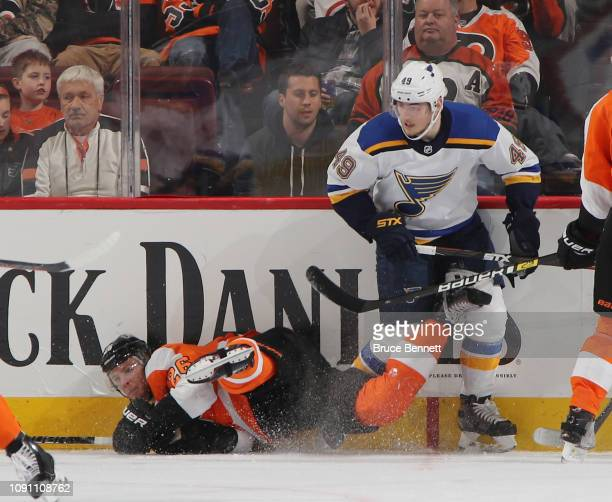 Christian Folin of the Philadelphia Flyers is tripped up by Ivan Barbashev of the St Louis Blues during the second period at the Wells Fargo Center...