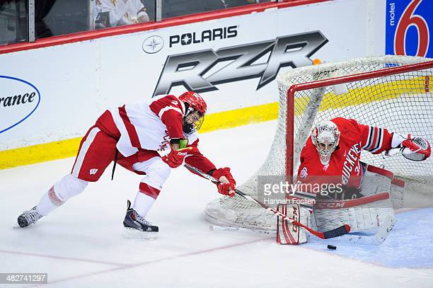 Christian Frey of the Ohio State Buckeyes defends the net from a shot by Michael Mersch of the Wisconsin Badgers during the Big Ten Men's Ice Hockey...