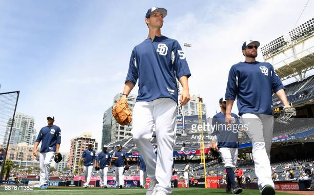 Christian Friedrich and players of the San Diego Padres walk off the field after batting practice prior to the game on Opening Day against the San...