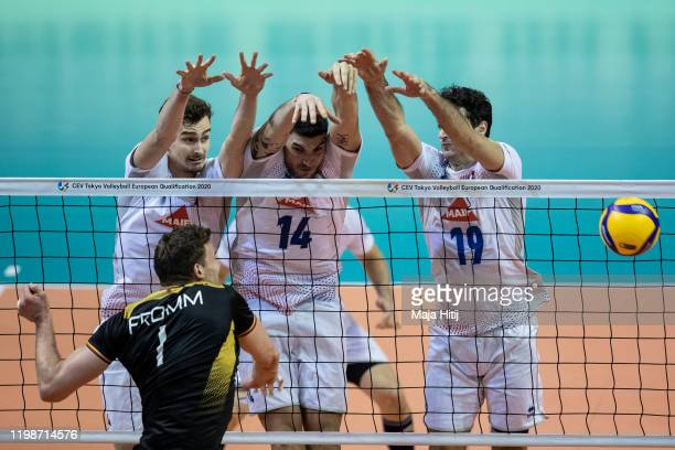 Christian Fromm of Germany in action against Jean Patry Nicolas Le Goff of France and Yacine Louati of France during the men final France against...