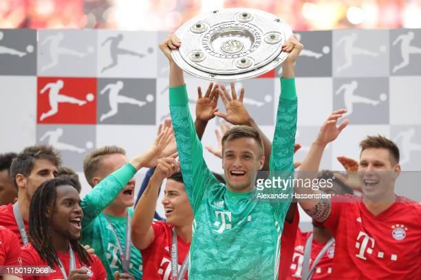 Christian Fruechtl of Bayern Munich lifts the trophy following the Bundesliga match between FC Bayern Muenchen and Eintracht Frankfurt at Allianz...