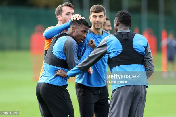 Christian Fuchs Aleksander Dragovic and Wilfred Ndidi share a joke with Kelechi Iheanacho during the Leicester City training session at Belvoir Drive...