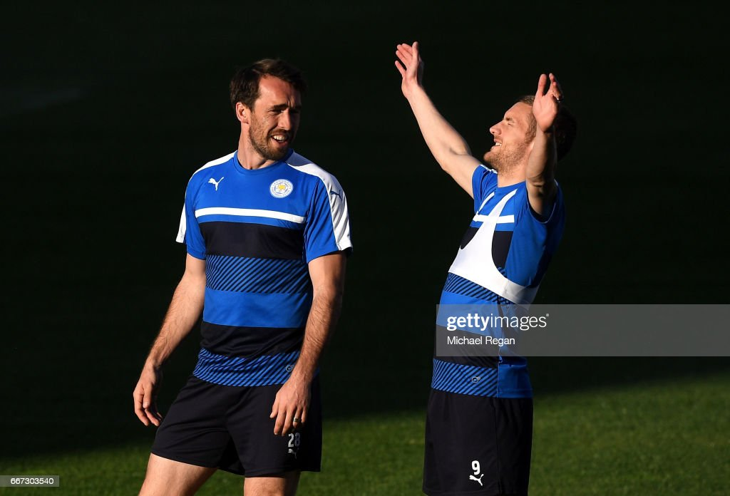 Christian Fuchs (L) and Jamie Vardy (R) share a joke during a Leicester City training session ahead of their UEFA Champions League Quarter-Final match against Atletico Madrid at Vicente Calderon Stadium on April 11, 2017 in Madrid, Spain.
