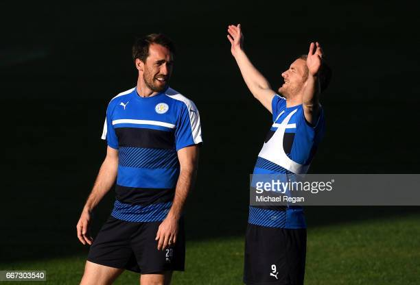 Christian Fuchs and Jamie Vardy share a joke during a Leicester City training session ahead of their UEFA Champions League QuarterFinal match against...