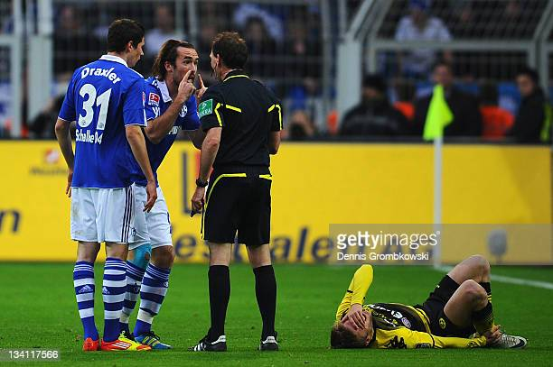 Christian Fuchs argues with referee Florian Meyer during the Bundesliga match between Borussia Dortmund and FC Schalke 04 at Signal Iduna Park on...