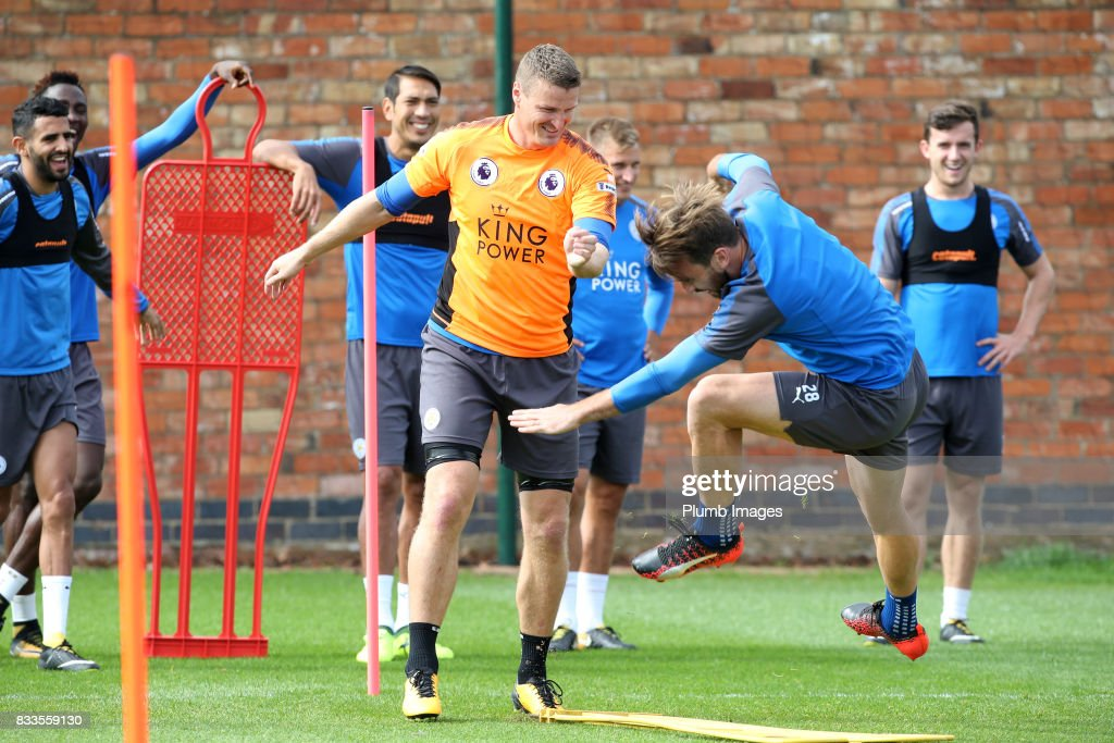 Christian Fuchs collides with Robert Huth during the Leicester City training session at Belvoir Drive Training Complex on August 17 , 2017 in Leicester, United Kingdom.