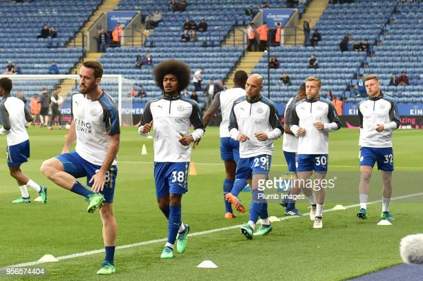 Christian Fuchs Hamza Choudhury Yohan Benalouane George Thomas and Harvey Barnes of Leicester City warm up ahead of the Premier League match between...