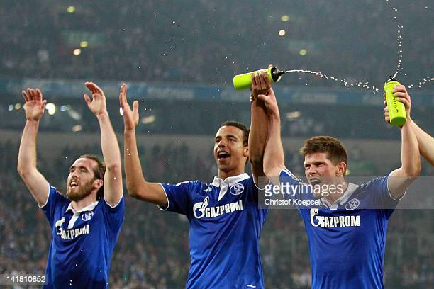 Christian Fuchs Joel Matip and KlaasJan Huntelaarof Schalke celebrate the 20 victory after the Bundesliga match between FC Schalke 04 and Bayer 04...
