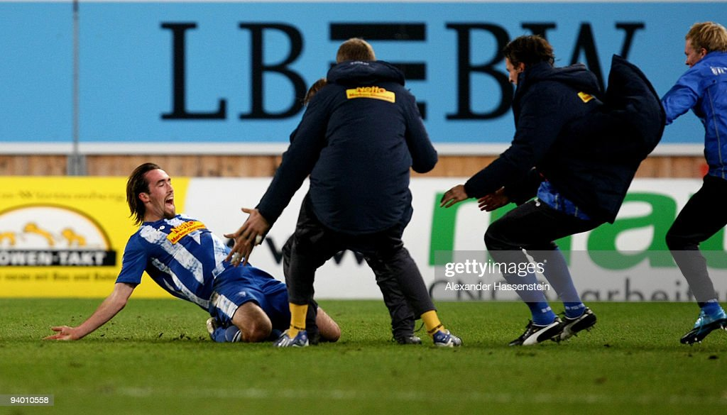 Christian Fuchs (L) of Bochum celebrates scoring the 2nd goal with his team mates during the Bundesliga match between VfB Stuttgart and VfL Bochum at Mercedes-Benz Arena on December 5, 2009 in Stuttgart, Germany.
