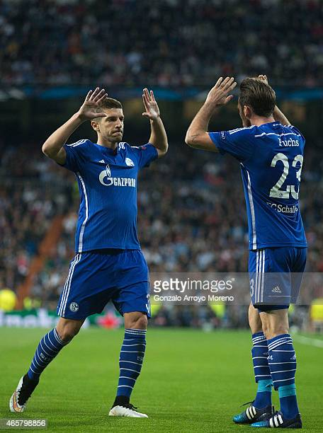 Christian Fuchs of FC Schalke 04 celebrates scoring their opening goal with teammate Matija Nastasic during the UEFA Champions League round of 16...