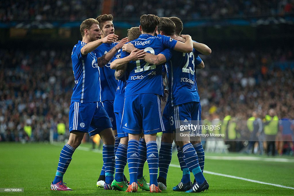 Christian Fuchs (R) of FC Schalke 04 celebrates scoring their opening goal with teammates during the UEFA Champions League round of 16 second leg match between Real Madrid CF and FC Schalke 04 at Estadio Santiago Bernabeu on March 10, 2015 in Madrid, Spain.