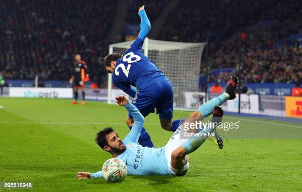 Christian Fuchs of Leicester City and Bernardo Silva of Manchester City during the Carabao Cup QuarterFinal match between Leicester City and...