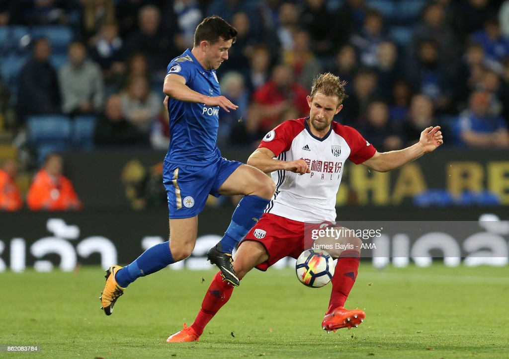 Christian Fuchs of Leicester City and Craig Dawson of West Bromwich Albion during the Premier League match between Leicester City and West Bromwich Albion at The King Power Stadium on October 16, 2017 in Leicester, England.