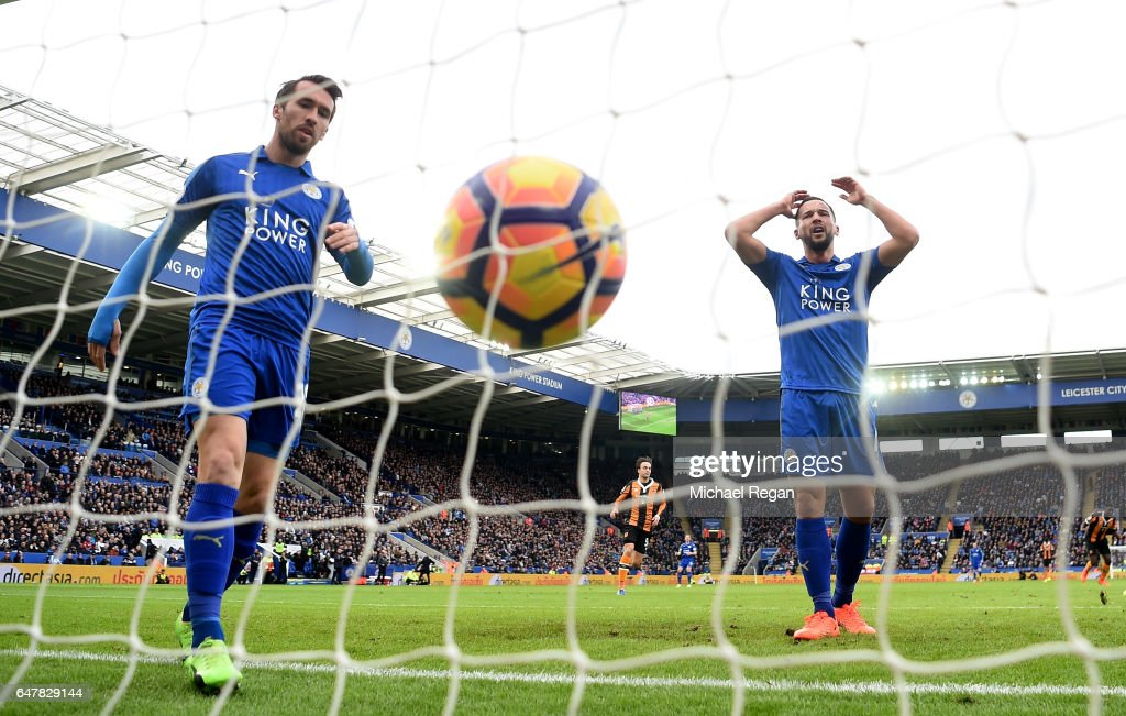 Christian Fuchs of Leicester City (L) and Danny Drinkwater of Leicester City (R) reacts to Hull City scoring their first goal during the Premier League match between Leicester City and Hull City at The King Power Stadium on March 4, 2017 in Leicester, England.