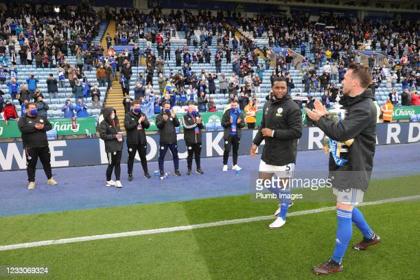 Christian Fuchs of Leicester City and Wes Morgan of Leicester City with the FA Cup trophy during a lap of the pitch after the Premier League match...