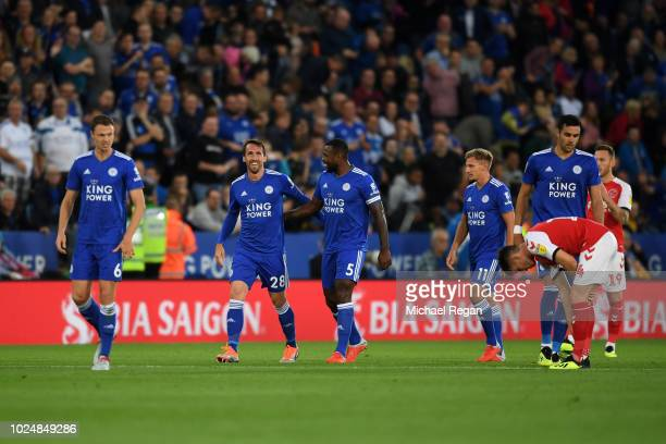 Christian Fuchs of Leicester City celebrates after scoring his team's first goal with team mate Wes Morgan during the Carabao Cup Second Round match...