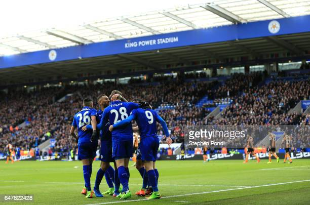 Christian Fuchs of Leicester City celebrates scoring his sides first goal with his Leicester City team mates during the Premier League match between...
