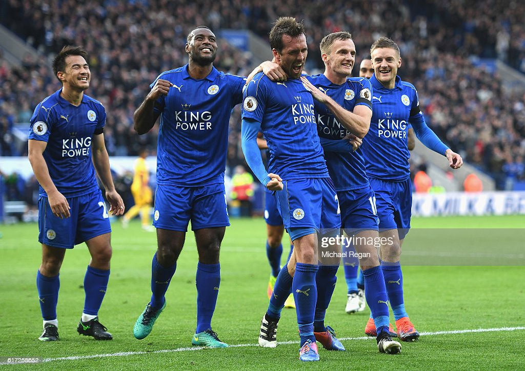 Christian Fuchs of Leicester City (C) celebrates scoring his sides third goal with his Leicester City team mates during the Premier League match between Leicester City and Crystal Palace at The King Power Stadium on October 22, 2016 in Leicester, England.