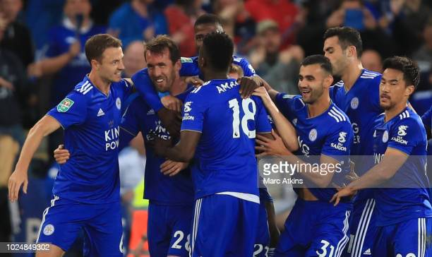 Christian Fuchs of Leicester City celebrates scoring the opening goal with team mates during the Carabao Cup Second Round match between Leicester...
