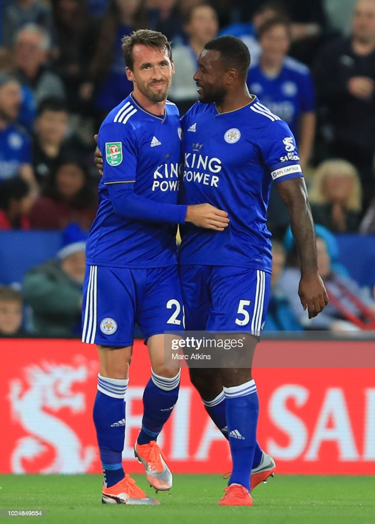 Christian Fuchs of Leicester City celebrates scoring the opening goal with Wes Morgan during the Carabao Cup Second Round match between Leicester City and Fleetwood Town at The King Power Stadium on August 28, 2018 in Leicester, England.