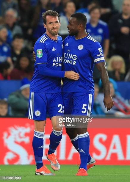 Christian Fuchs of Leicester City celebrates scoring the opening goal with Wes Morgan during the Carabao Cup Second Round match between Leicester...