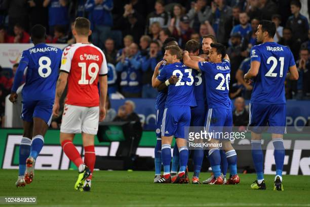 Christian Fuchs of Leicester City celebrates with team mates after scoring his team's first goal during the Carabao Cup Second Round match between...