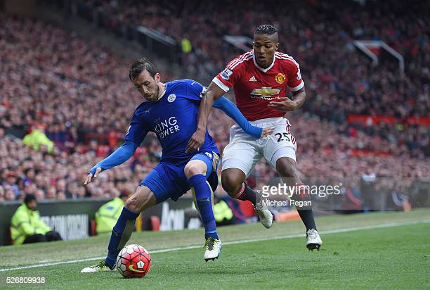 Christian Fuchs of Leicester City holds off Antonio Valencia of Manchester United during the Barclays Premier League match between Manchester United...