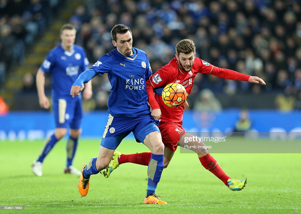 Christian Fuchs of Leicester City in action with Adam Lallana of Liverpool during the Barclays Premier League match between Leicester City and Liverpool at the King Power Stadium on February 02 , 2016 in Leicester, United Kingdom.