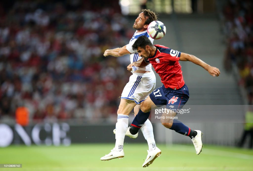 Christian Fuchs of Leicester City in action with Zeki Celik of Lille during the pre-season friendly match between Lille and Leicester City at Stade Pierre Mauroy on August 4, 2018 in Lille, France.