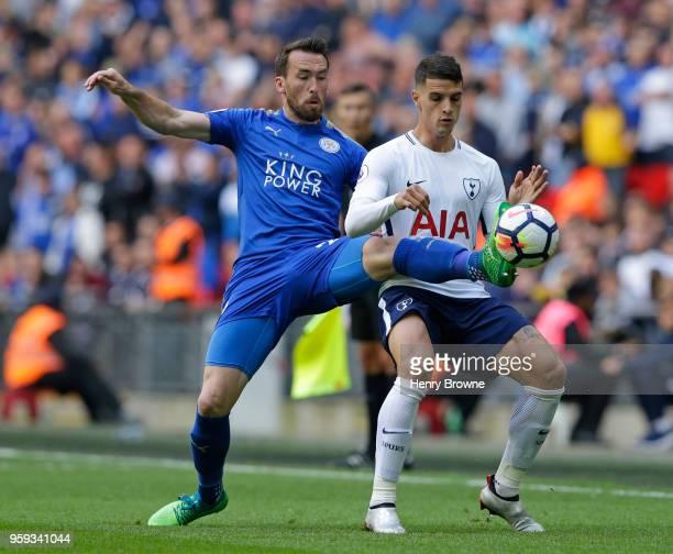Christian Fuchs of Leicester City kicks the ball against Erik Lamela of Tottenham Hotspur during the Premier League match between Tottenham Hotspur...