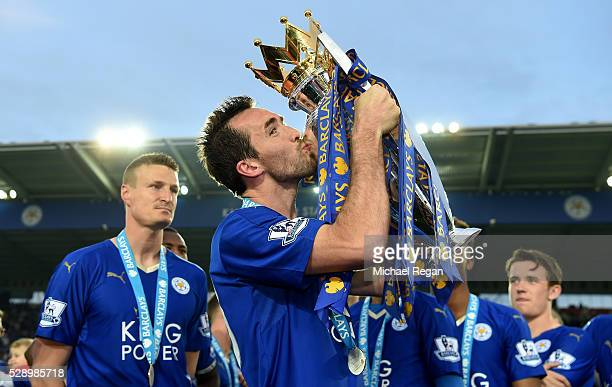 Christian Fuchs of Leicester City kisses the Premier League Trophy as players and staffs celebrate the season champions after the Barclays Premier...