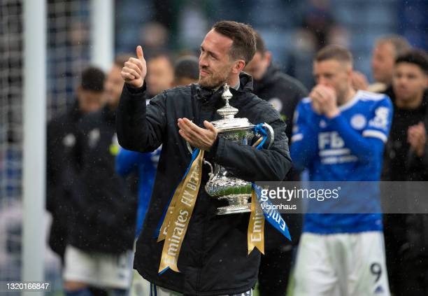 Christian Fuchs of Leicester City parades the FA Cup trophy after the Premier League match between Leicester City and Tottenham Hotspur at The King...
